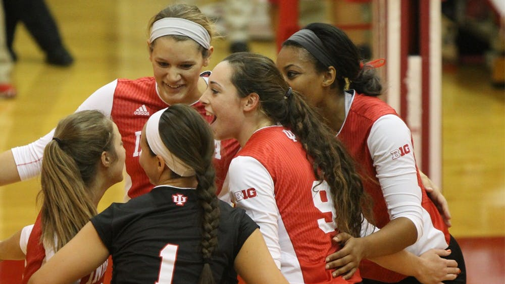 Members of the IU women's volleyball team celebrate after scoring a point during the Hoosiers' game against Bowling Green on Saturday. IU swept the Indiana Invitational.