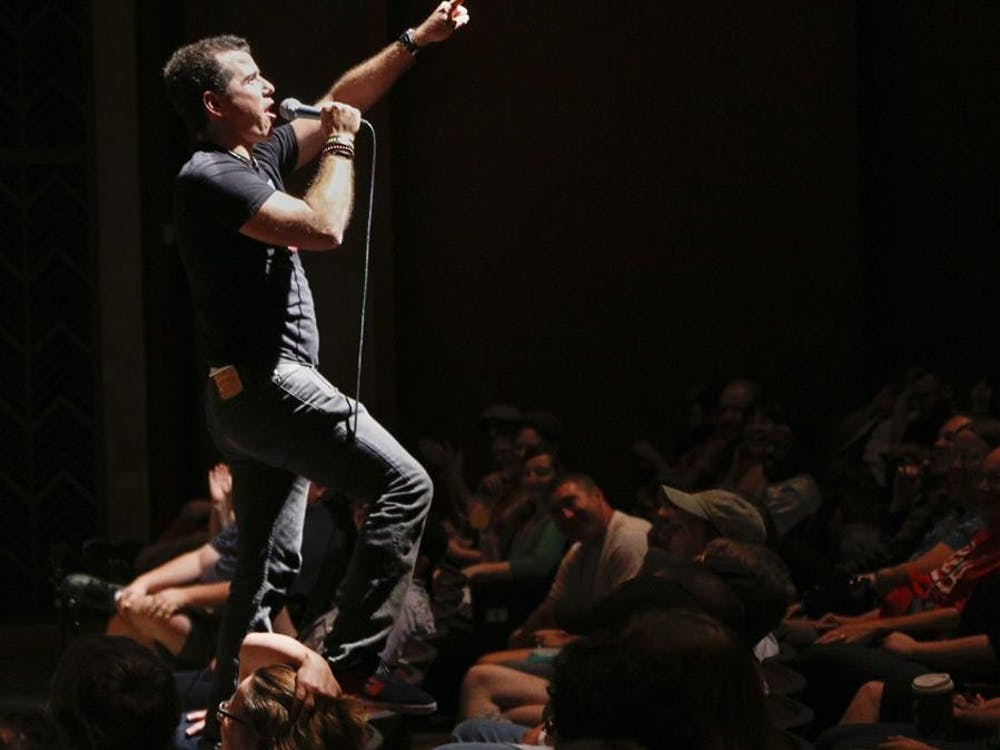 """Comedian Graham Elwood sings Bon Jovi's """"Wanted Dead or Alive"""" while standing on a chair before a recording of The Doug Benson Movie Interruption during the Limestone Comedy Festival on Saturday at the Buskirk-Chumley Theater."""