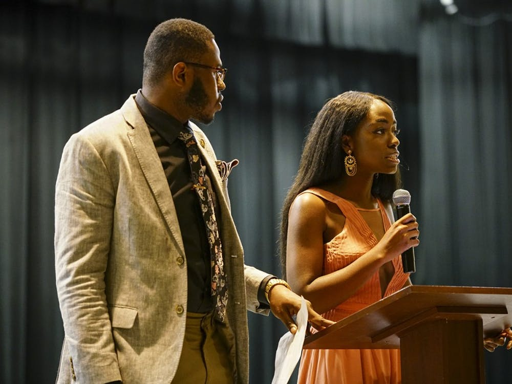 African Students' Association President Dara Adeosun and Alpha Phi Alpha Vice President Morris Dolley open the Banquet Dinner Saturday evening in the Willkie Auditorium. The annual event was hosted by ASA in collaboration with Alpha Phi Alpha fraternity and Alpha Kappa Alpha sorority to raise money for Freetown, Sierra Leone, with World Hope International after the city suffered heavy flooding and mudslides in August.