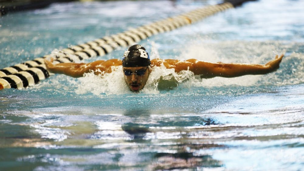 Senior Vinicius Lanza swims the butterfly stroke during the individual medley Nov. 11 at the Boilermaker Aquatic Center. IU helped lead the Big Ten over the ACC at the ACC/Big Ten Challenge on Nov. 10 and 11.