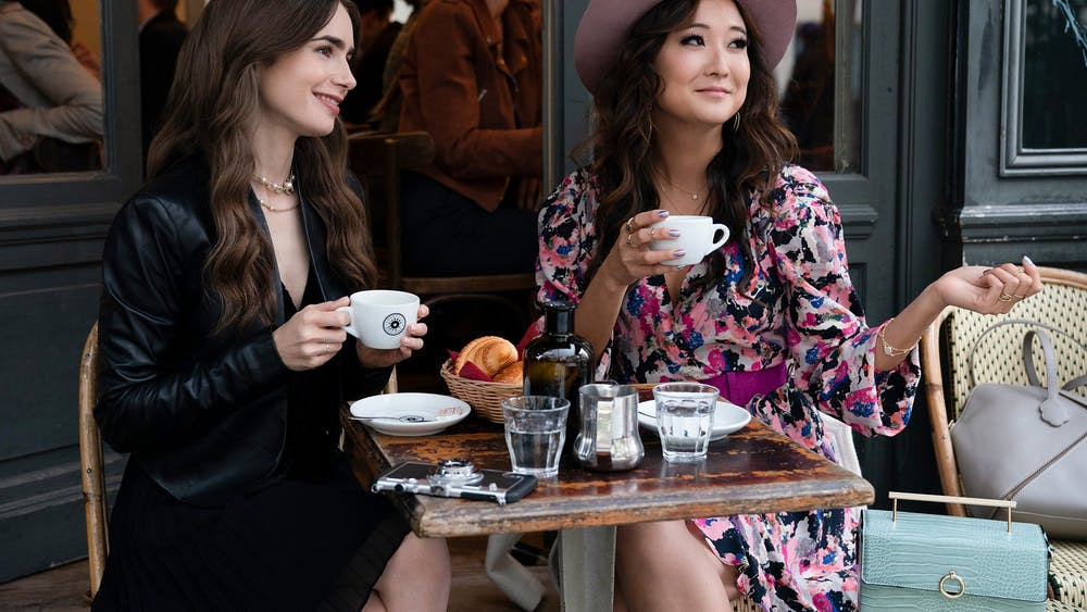 "Ashley Park and Lily Collins in ""Emily in Paris."""