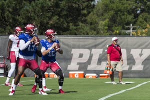 Graduate transfer quarterback Brandon Dawkins, left, and sophomore quarterback Peyton Ramsey, right, participate in drills Aug. 6 during practice at the IU Football practice fields. Dawkins and Ramsey, along with freshman Michael Penix Jr., are competing for the Hoosiers' starting quarterback position in 2018.