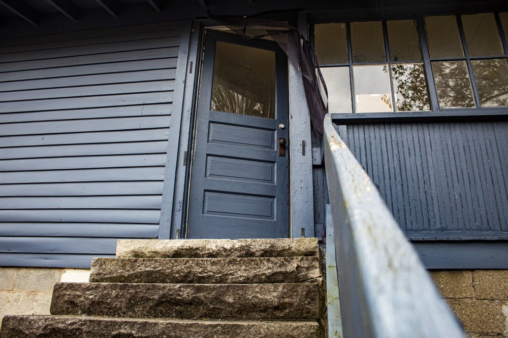 <p>The door stands ajar Oct. 25 as the tenants move out of the Brickhouse. The tenants of the house were forced to move out roughly two weeks following the shooting.</p>