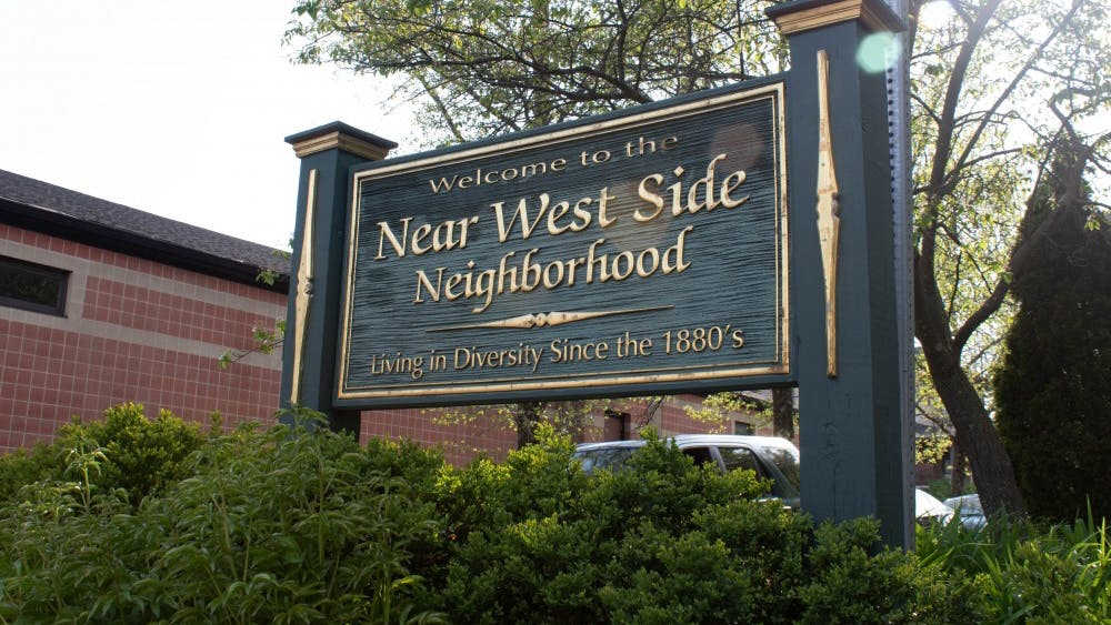A Near West Side Neighborhood sign stands at the intersection of Sixth and Rogers streets. The neighborhood has been developing since 1884, according to the city's official website.
