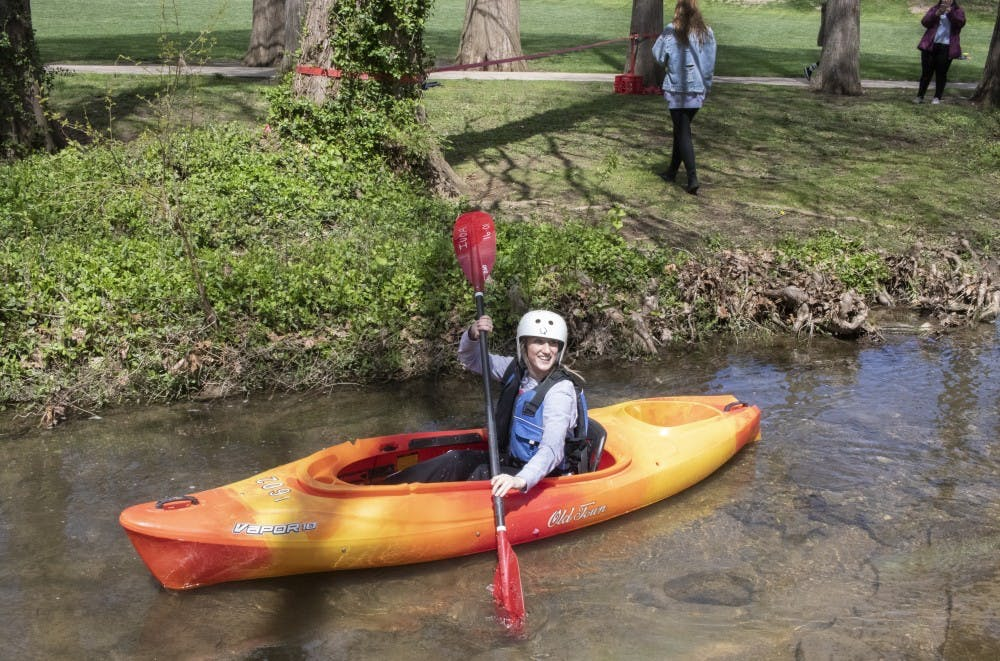 <p>Then Sophomore Jillian Tomes kayaks on the Campus River on April 15 behind Franklin Hall. People who want to canoe, kayak or stand-up paddleboard on a lake can rent boats at Griffy Lake.</p>