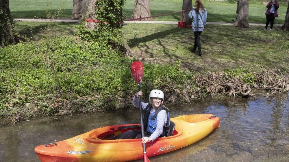 Then Sophomore Jillian Tomes kayaks on the Campus River on April 15 behind Franklin Hall. People who want to canoe, kayak or stand-up paddleboard on a lake can rent boats at Griffy Lake.