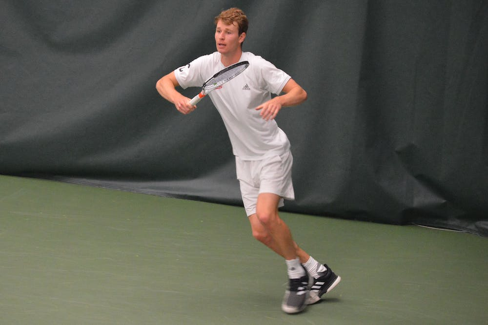 Graduate student Bennett Crane prepares to receive the ball April 11 at the IU Tennis Center. The IU men's tennis team lost 4-0 to No. 14 Illinois on Friday at the Big Ten Championships in Lincoln, Nebraska.