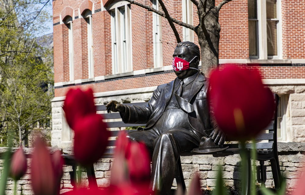 <p>A face mask covers the face of the Herman B Wells statue April 20 on IU's campus. IU released more specific information about how the university will handle COVID-19 issues this fall in a July 30 webinar.</p>