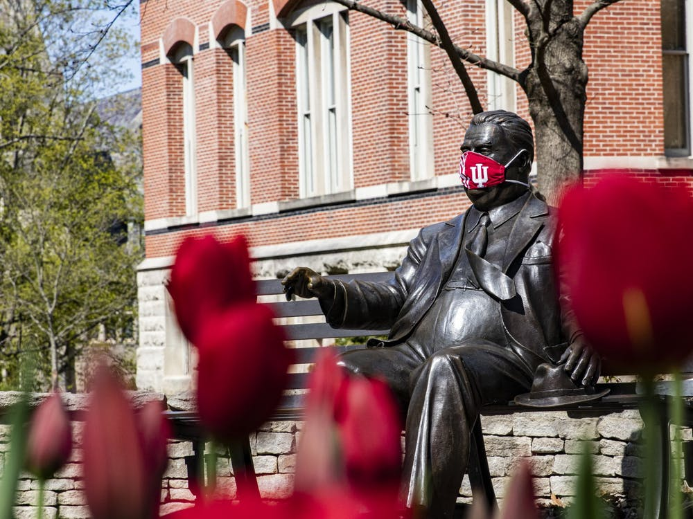 A face mask covers the face of the Herman B Wells statue April 20 on IU's campus. IU released more specific information about how the university will handle COVID-19 issues this fall in a July 30 webinar.