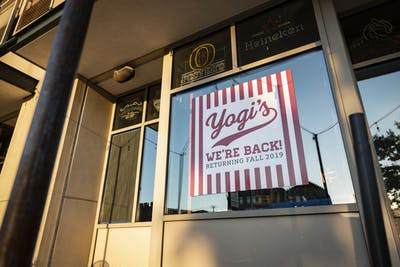 A sign for Yogi's hangs in the window of the former Scotty's Brewhouse location Sept. 18 on Walnut Street. Yogi's will reopen Monday.