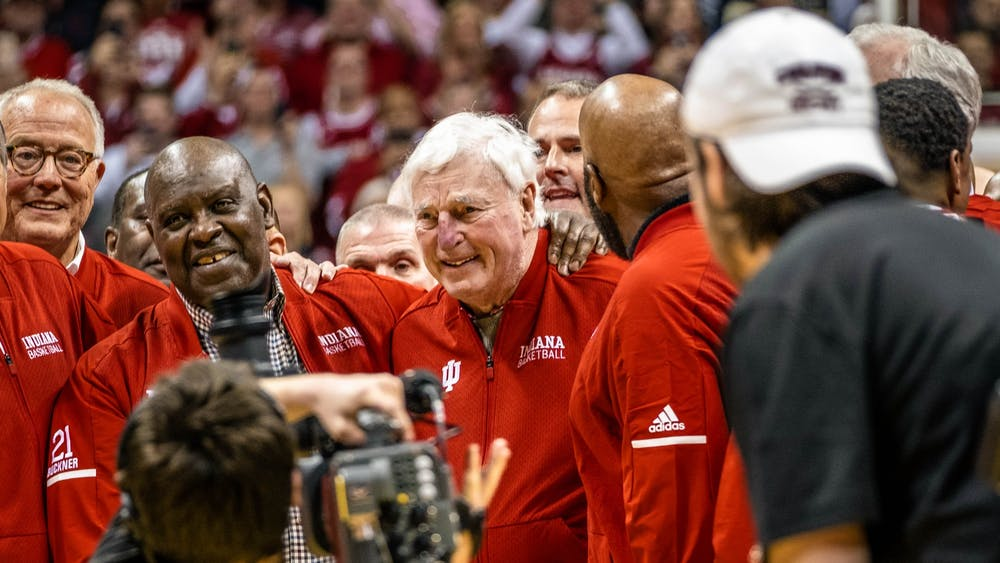 Former IU men's basketball head coach Bob Knight stops for photos at half court with former IU players Feb.8 in Simon Skjodt Assembly Hall. This was Knight's first time back to Simon Skjodt Assembly Hall since he was fired in 2000.