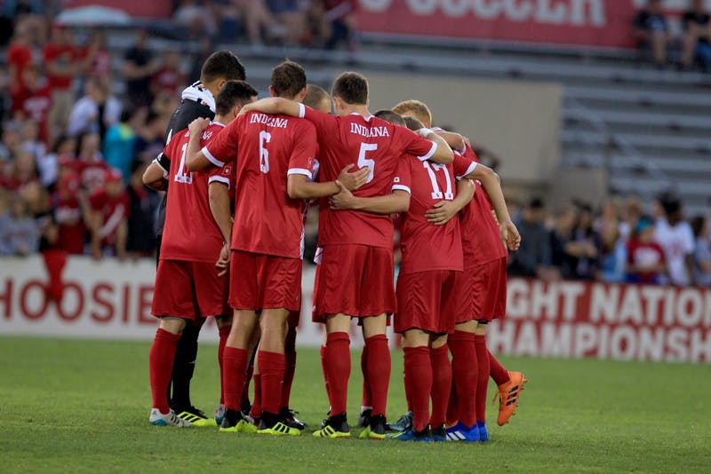 Members of the IU men's soccer team huddle before the first home game Aug. 31. IU's match with Northwestern on Sept. 25 was cancelled due to rain.