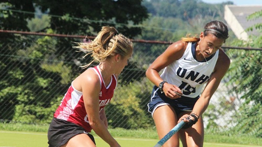 Junior, Taylor Pearson, plays defence against University of New Hampshire Sunday at the IU Field Hockey Complex.