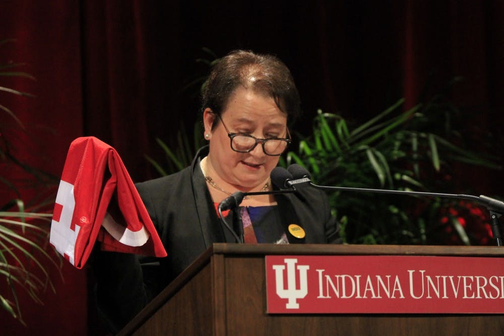 <p>Provost Lauren Robel holds an IU flag she said she always keeps with her. Robel spoke about her time in India for India Remixed, which is designed to support global learning, international cultural exchanges and IU ambassadorship.</p>