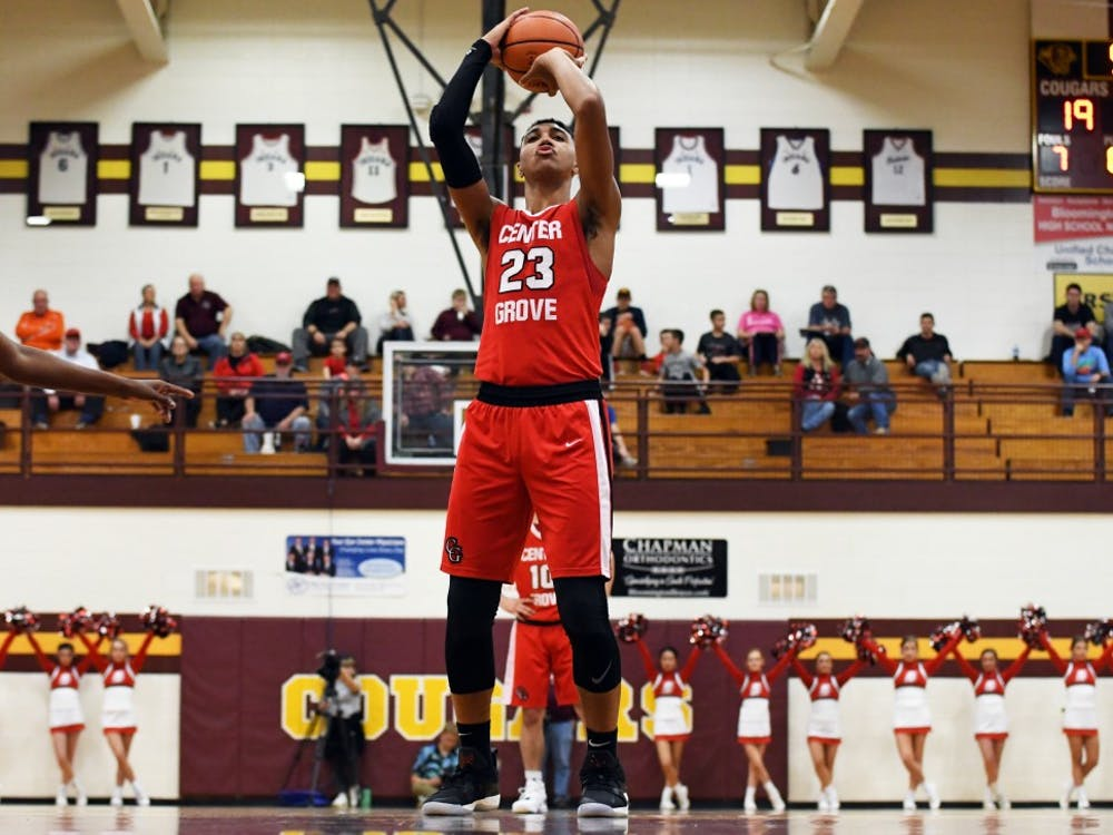 Center Grove's Trayce Jackson-Davis attempts a free throw against Bloomington North on Saturday evening at Tom McKinney Court. Jackson-Davis had 33 points and 12 rebounds.