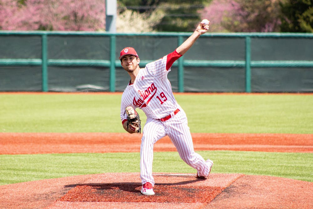 <p>Junior pitcher Tommy Sommer pitches in the first game of a doubleheader against Minnesota on April 23 at Bart Kaufman Field. IU will compete against Iowa this weekend.</p>