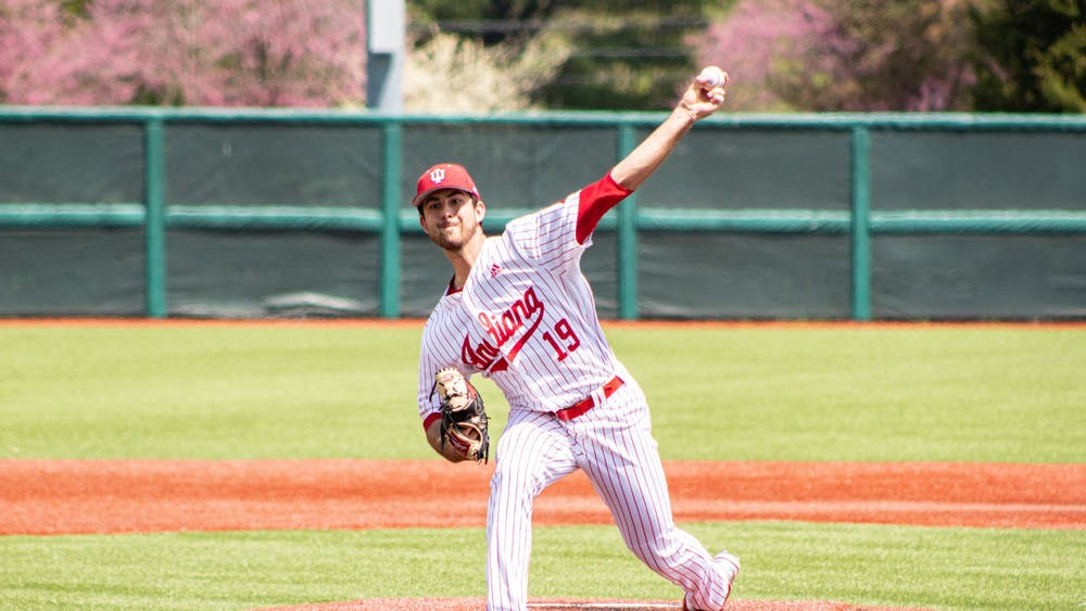 Junior pitcher Tommy Sommer pitches in the first game of a doubleheader against Minnesota on April 23 at Bart Kaufman Field. IU will compete against Iowa this weekend.