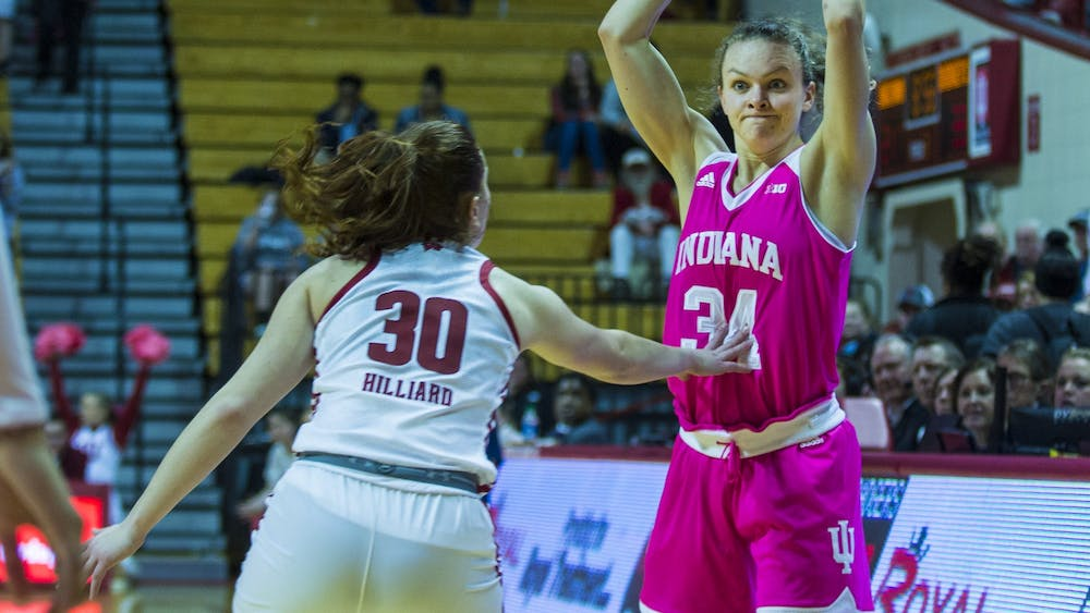 Sophomore Grace Berger looks for an open player Jan. 30 against Wisconsin at Simon Skjodt Assembly Hall. No. 20 IU beat Wisconsin 75-65 in overtime.
