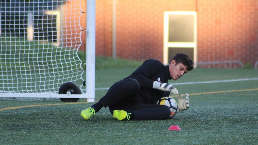 Freshman goalkeeper Trey Muse saves a shot during warm-ups before IU's match against the Butler Bulldogs Oct. 18 in Indianapolis. Muse allowed no goals during the IU Credit Union/Adidas Classic.