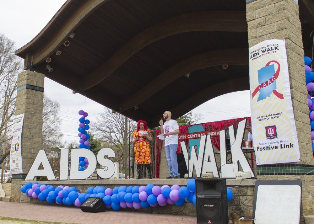 <p>Argenta Peron and Jeremy Turner introduce the South Central Indiana AIDS Walk with opening remarks Friday at the Waldron Hill Buskirk Park. Peron flew in from Hawaii to participate in the event to raise awareness in the fight against AIDS.&nbsp;</p>