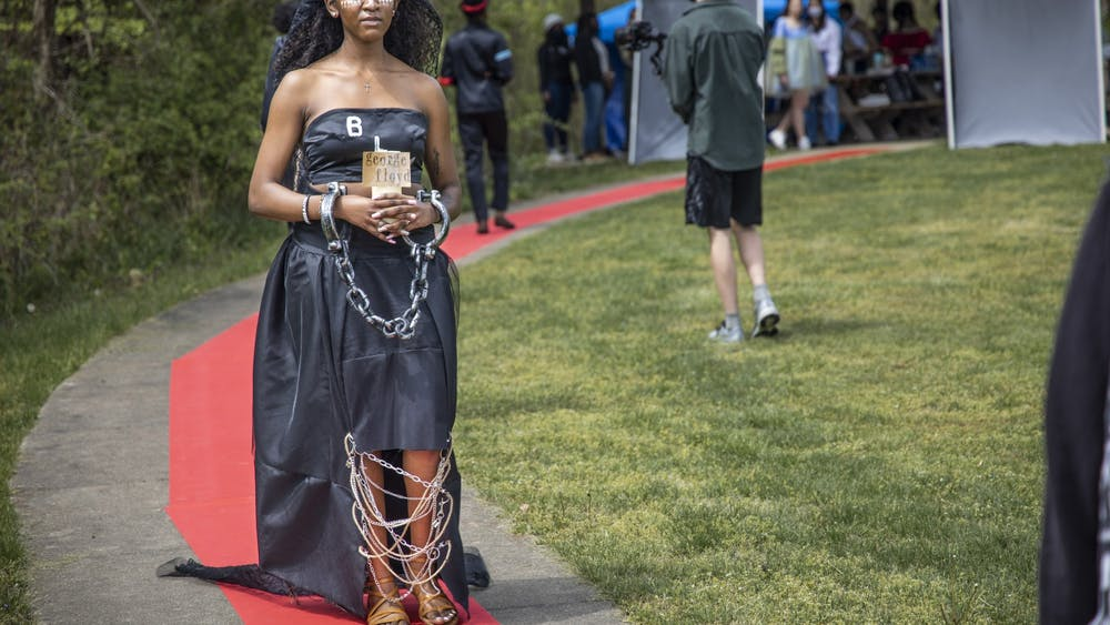 Junior Mahogany Simpson walks down the runway wearing a dress designed and created by senior Deyjah Lee. The student-created fashion show was at 2 p.m. Sunday in Fairfax State Recreation Area.