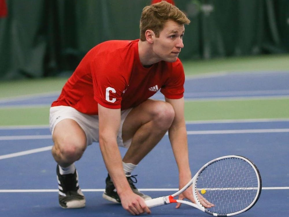 Senior Andrew Redding scopes out the court March 13 at the IU Tennis Center. The IU men's tennis team beat Wisconsin 5-2 on Friday in Madison, Wisconsin.