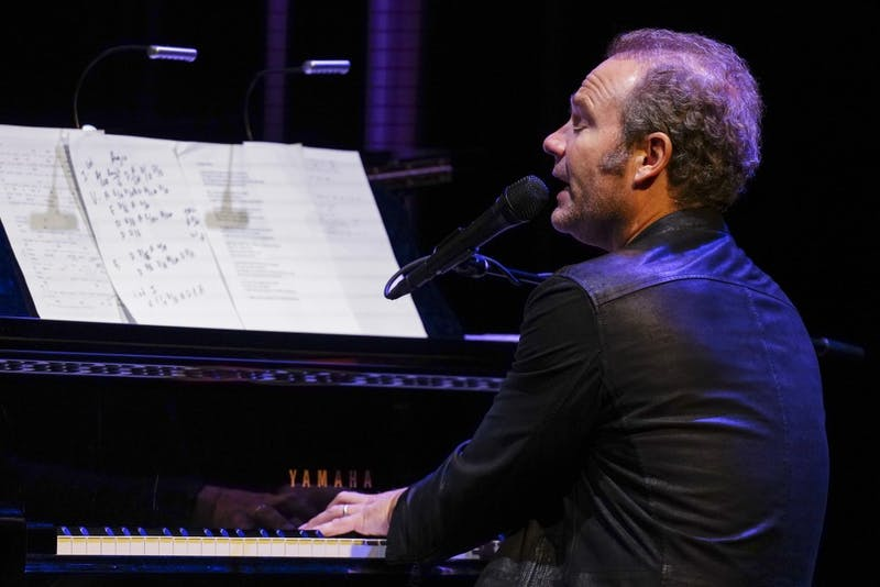 """John Ondrasik of Five for Fighting performs, tells life stories and interacts with the crowd during his performance Sept. 22 at the Buskirk-Chumley Theater. Ondrasik alternated between a guitar and a piano and was accompanied by a string quartet as he performed fan favorites and popular singles """"100 Years,"""" """"Superman (It's Not Easy)"""" and """"Chances."""""""