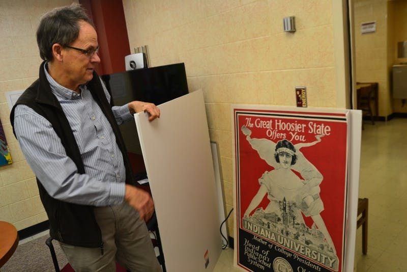 University Historian James Capshew shows an early 1900s-era advertisement for IU on Feb. 1 in his office at Herman B Wells Library.