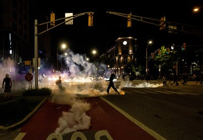 Tear gas rolls down the street May 30 in Indianapolis. Police used tear gas to break up the protest, which was in response to the killing of George Floyd by Minneapolis police officer Derek Chauvin on May 25.