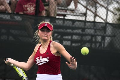 Then-junior Madison Appel eyes a forehand during her 4-6, 3-6 singles loss to Ohio State in the 2018 season. Appel plays her final match of her collegiate career at the IU Tennis Center this weekend.