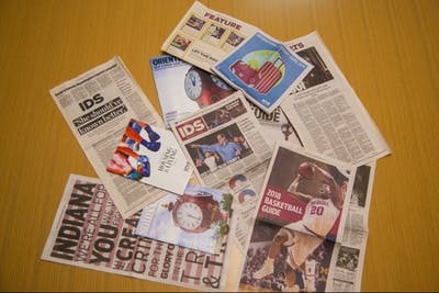 A collection of publications of the Indiana Daily Student lay on a table. The IDS won 26 Columbia Scholastic Press Association Awards at the annual ceremony.