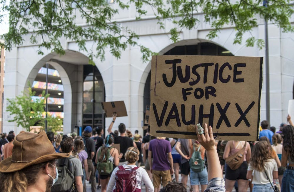 <p>A protester holds up a sign July 6 in front of the Charlotte Zietlow Justice Center. Vauhxx Booker, a human rights advocate who is Black, reflected on a July 2020 incident at Lake Monroe on the one year anniversary of the encounter. </p>