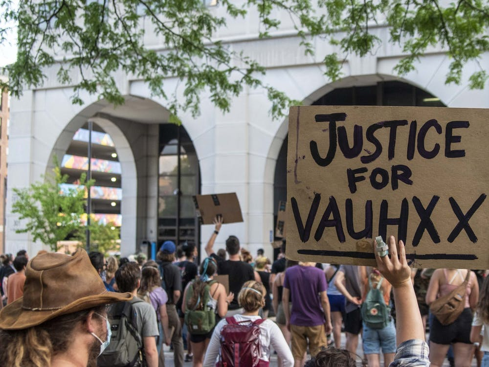 A protester holds up a sign July 6 in front of the Charlotte Zietlow Justice Center. Vauhxx Booker, a human rights advocate who is Black, reflected on a July 2020 incident at Lake Monroe on the one year anniversary of the encounter.