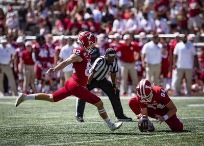 "Fifth-year kicker Logan Justus kicks a field goal during IU's game against Ohio State on Sept. 14 at Memorial Stadium. ""Focus on technique,"" Justus said. ""The distance will come."""