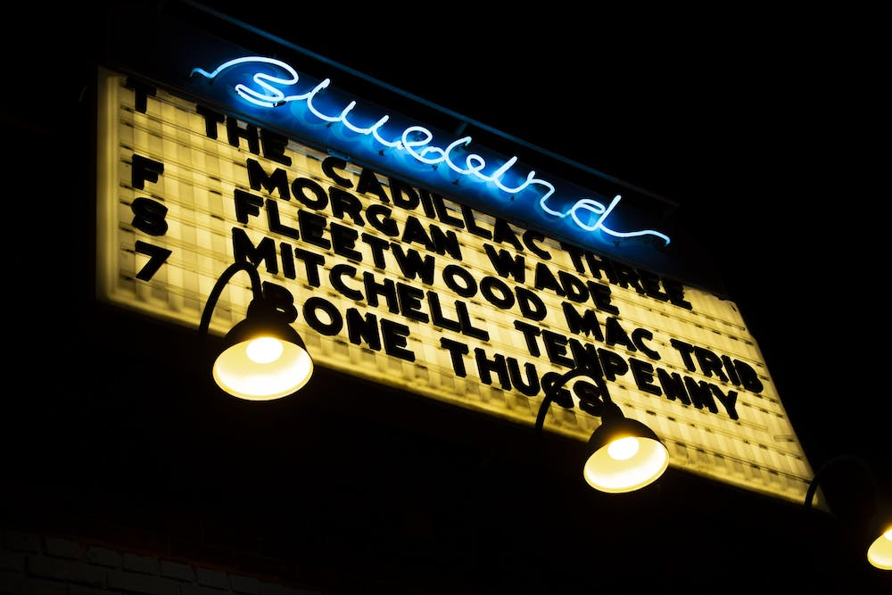 <p>A sign is lit up for the Cadillac Three Jan. 30, 2020, outside the Bluebird. The Bluebird temporarily shut down Thursday to create a plan for COVID-19 safety and compliance. </p>