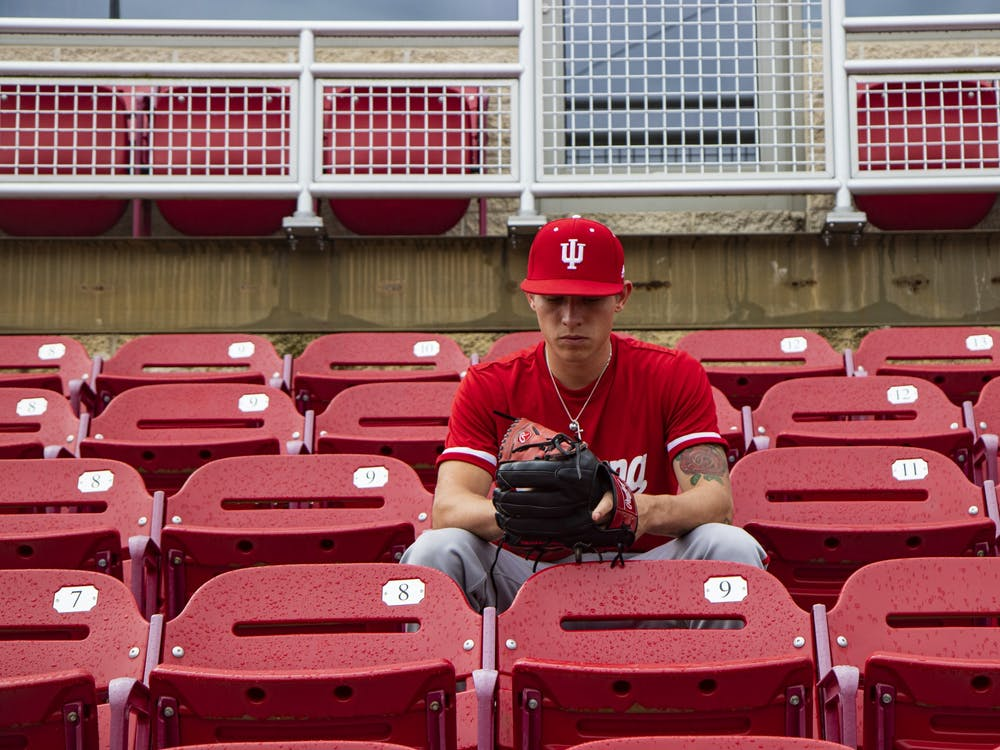 Sophomore pitcher Gabe Bierman looks down at his baseball glove Oct. 19, 2019, at Bart Kaufman Field. Bierman will play his second consecutive season for IU in 2020.