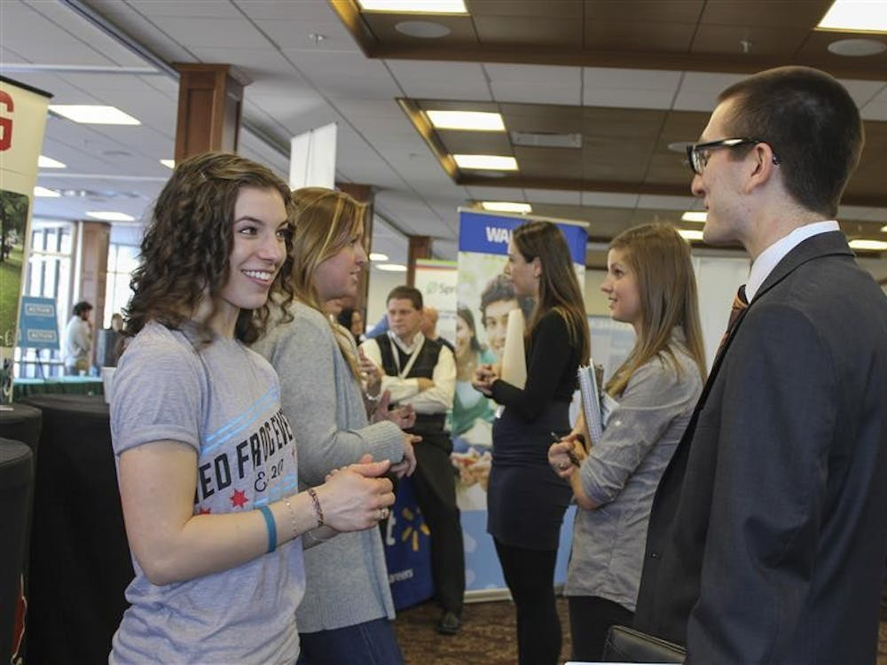 Sophomore business student Owen Hoepfner speaks with Red Frog Events event coordinator intern Samantha Soury about internship opportunities at the Winter Career and Internship Fair Wednesday afternoon in Alumni Hall.