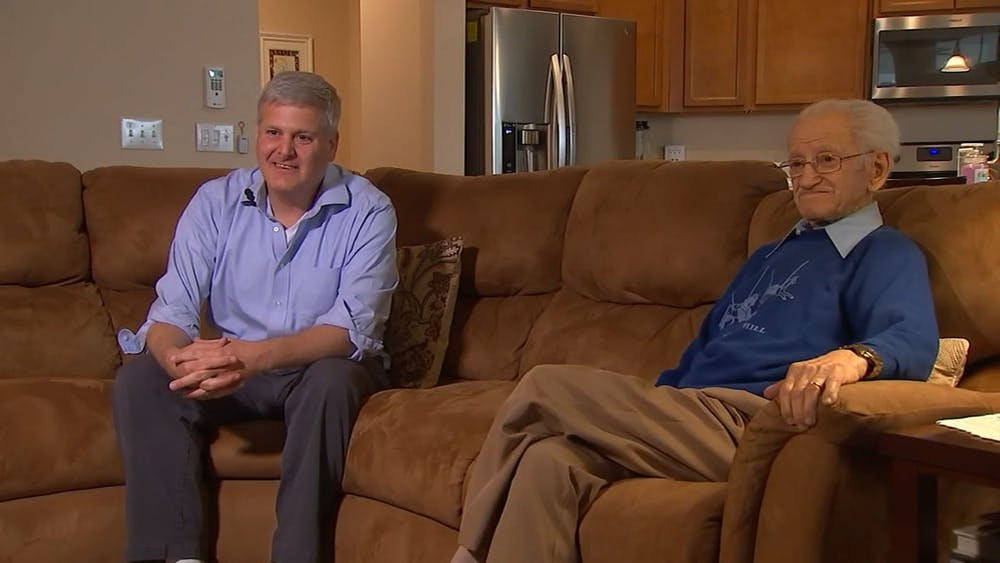 Abe Piasek, a Holocaust survivor, and Steve Goldberg sit during an interview with ABC News on April 2019 at Piasek's daughter's house. Holocaust educator Steve Goldberg will tell Piasek's story at an event Oct. 18, 2021.