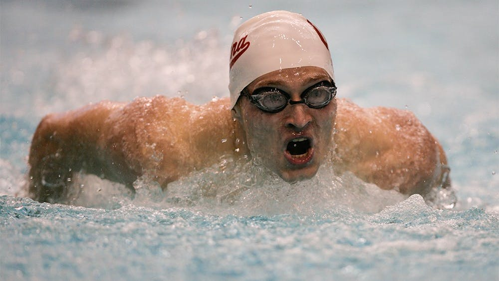 Junior Max Irwin comes into the wall during the first length of the 200M Butterfly. The Hoosiers competed in a duel meet against the Wisconsin Badgers on November 13th, 2015, with the men winning 184-116 and the women winning 182-114.