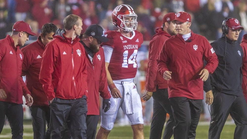 Redshirt junior quarterback Jack Tuttle walks off after a big hit Oct. 23, 2021, at Memorial Stadium. IU lost to Ohio State 54-7.