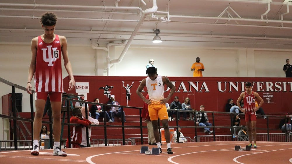 Runner Jalen Royal and his teammates prepare to run the 400-meter run Jan. 5 in Gladstein Fieldhouse. IU competed against University of Tennessee's track and field team.
