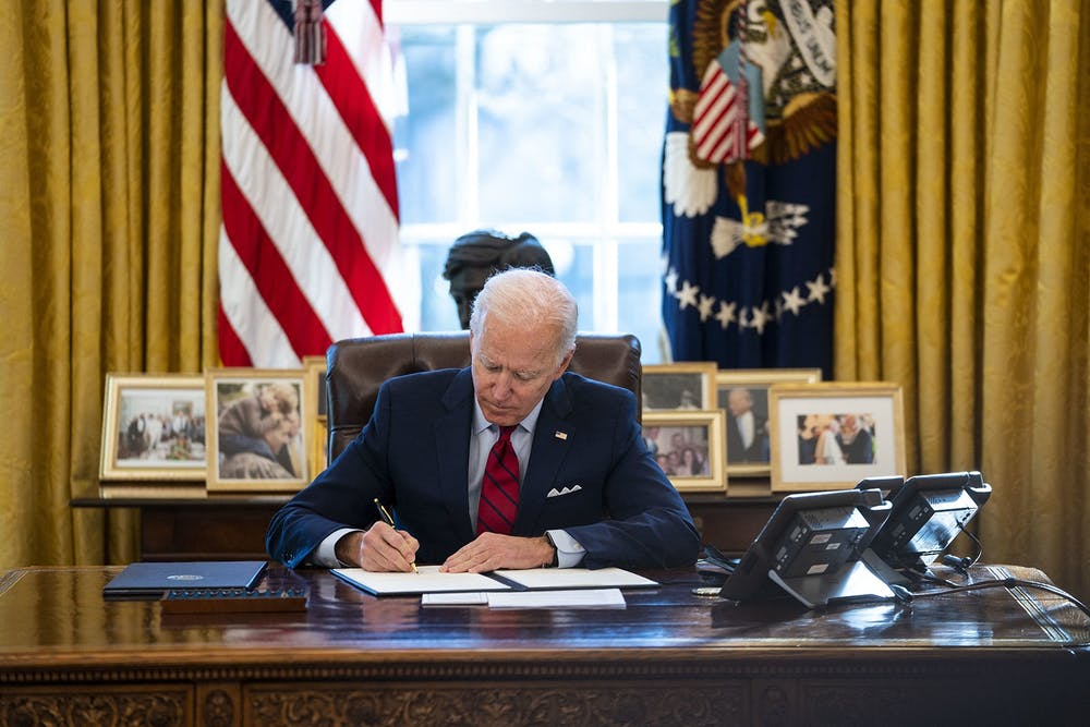 <p>President Joe Biden signs an executive order combatting xenophobia toward Asian-Americans and Pacific Islanders on Jan. 26 in the Oval Office. Part of the executive order includes a requirement that the Department of Justice must increase the collection of hate crime incident reports. </p>