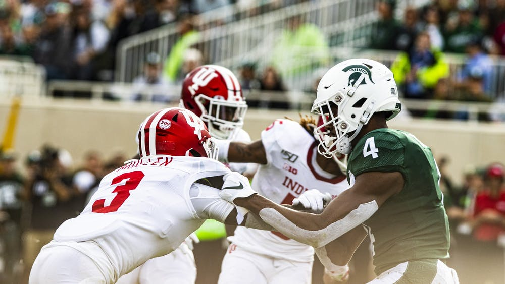 Freshman defensive back Tiawan Mullen attempts to block Michigan State University sophomore wide receiver C.J. Hayes on Sept. 28 in Spartan Stadium. Mullen was involved in two of the first-half fumbles Nov. 2 made by IU's defense against Northwestern.