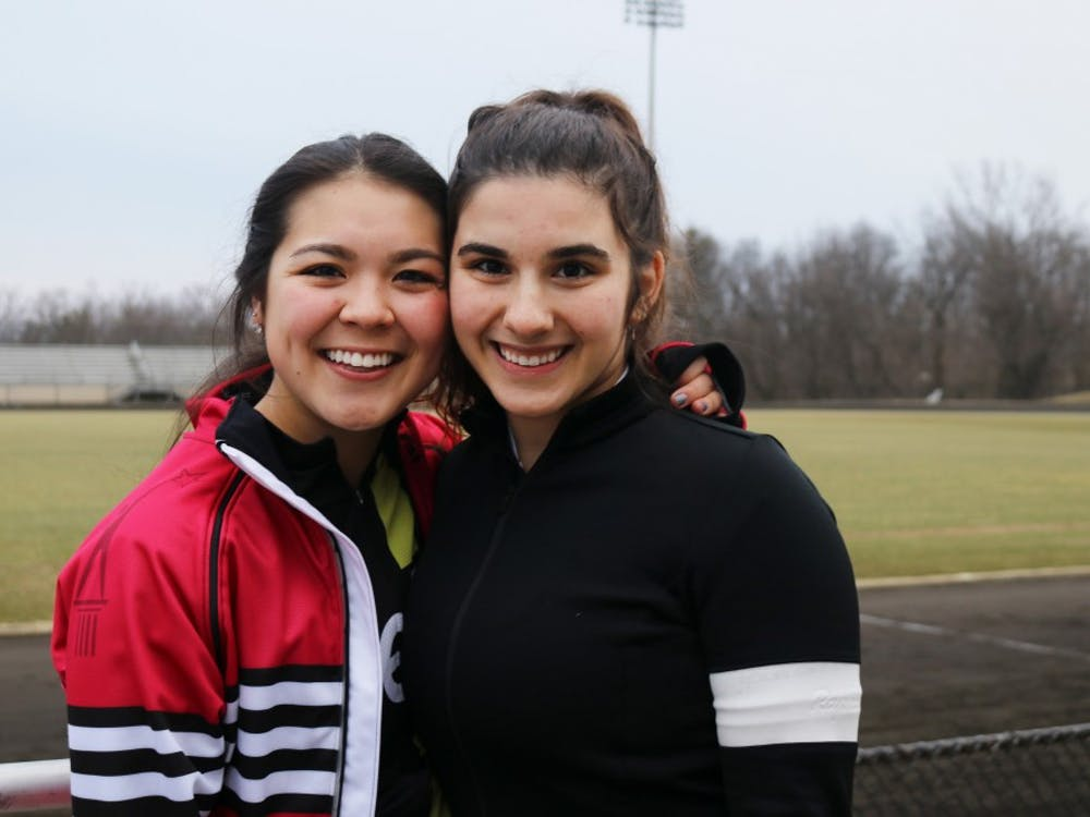 Kappa Alpha Theta Bike Team Rookie Anna Young is supported by veteran rider Erika Arakawa during Rookie Week for the 2019 Little 500 race. Rookie week requires first-time riders to practice 15.5 hours on the track.