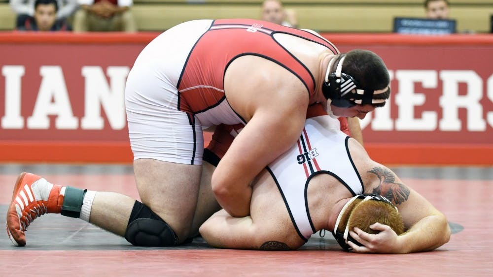 Junior Fletcher Miller and sophomore Zach Horwitz wrestle in the 285 -b weight class in the Cream and Crimson dual on Oct. 26 at University Gym. Miller defeated Horwitz by major decision, 16-5.
