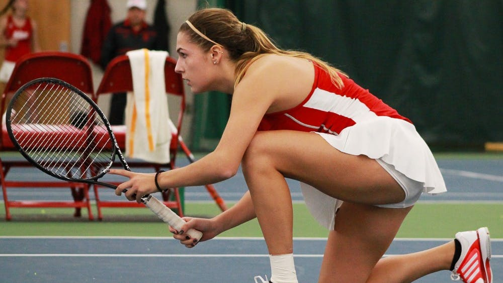 Then-sophomore Natalie Whalen, now a junior, waits for her partner to serve the ball in a February doubles match. Whalen's career was in doubt after suffering a herniated disc injury her freshman year.