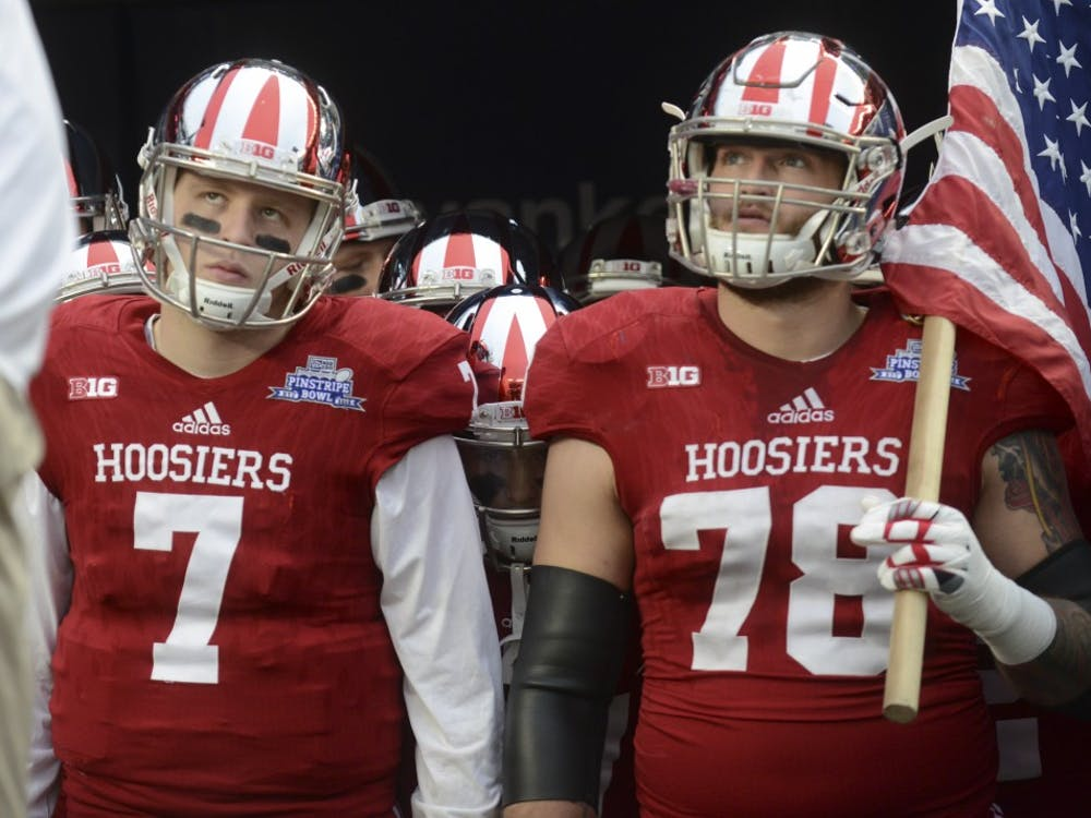 Quarterback Nate Sudfeld and offensive tackle Jason Spriggs lookup to the crowd before being running onto the field before the Pinstripe Bowl against Duke on Dec. 26 at Yankee Stadium.