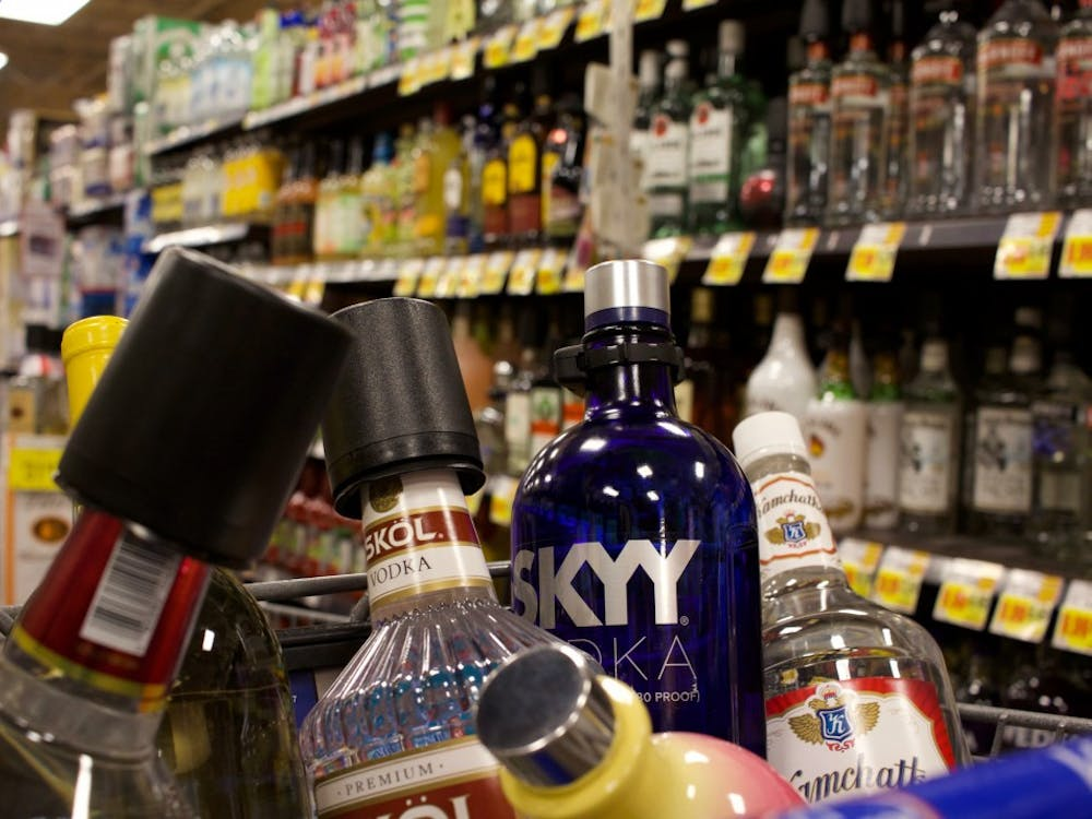 Bottles of alcohol fill a cart inside a Bloomington grocery store. After Gov. Eric Holcomb signed Senate Bill 1 into law Feb. 28, Sunday carryout alcohol sales officially became legal in Indiana.
