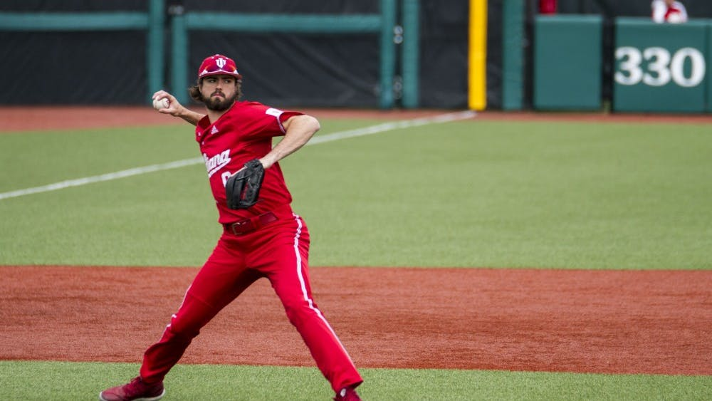 Junior third baseman Luke Miller throws the ball to first base to get the out against Butler on Saturday, March 31. Miller signed with the Philadelphia Phillies Tuesday.
