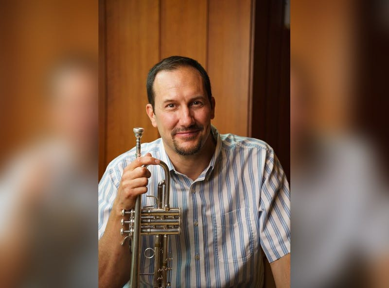 Trumpeter Kevin Cobb poses for a headshot. Cobb will join the IU Jacobs School of Music staff in the fall as one of three trumpet faculty members.